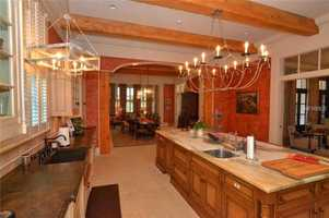The kitchen unfolds into a gorgeous dining area.