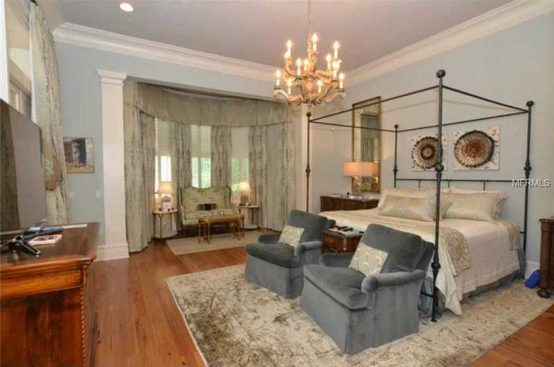 The master suite is luxury at its finest boasting hardwood floors and newly designed custom closets.