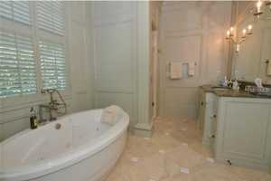 The master bathroom features an impressive new steam shower & spa tub.