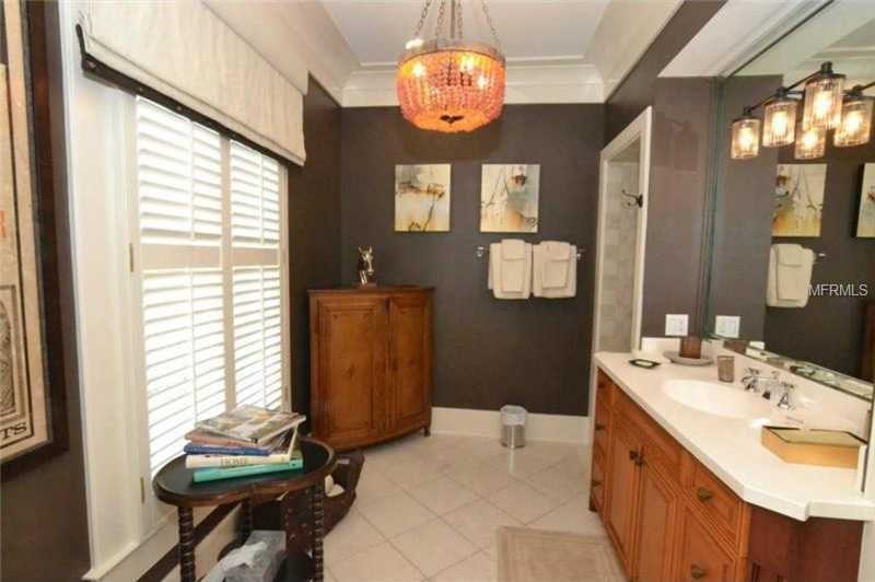 This en suite bathroom echoes the same tasteful decorating themes seen throughout the home.