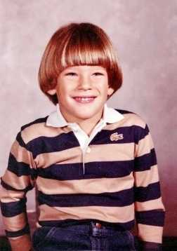 The hair style has changed since then, but the face is a dead giveaway. Can you guess who this is?
