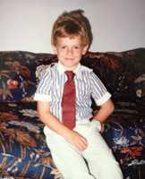 He even wore a tie back then. Who is this stylish kid?