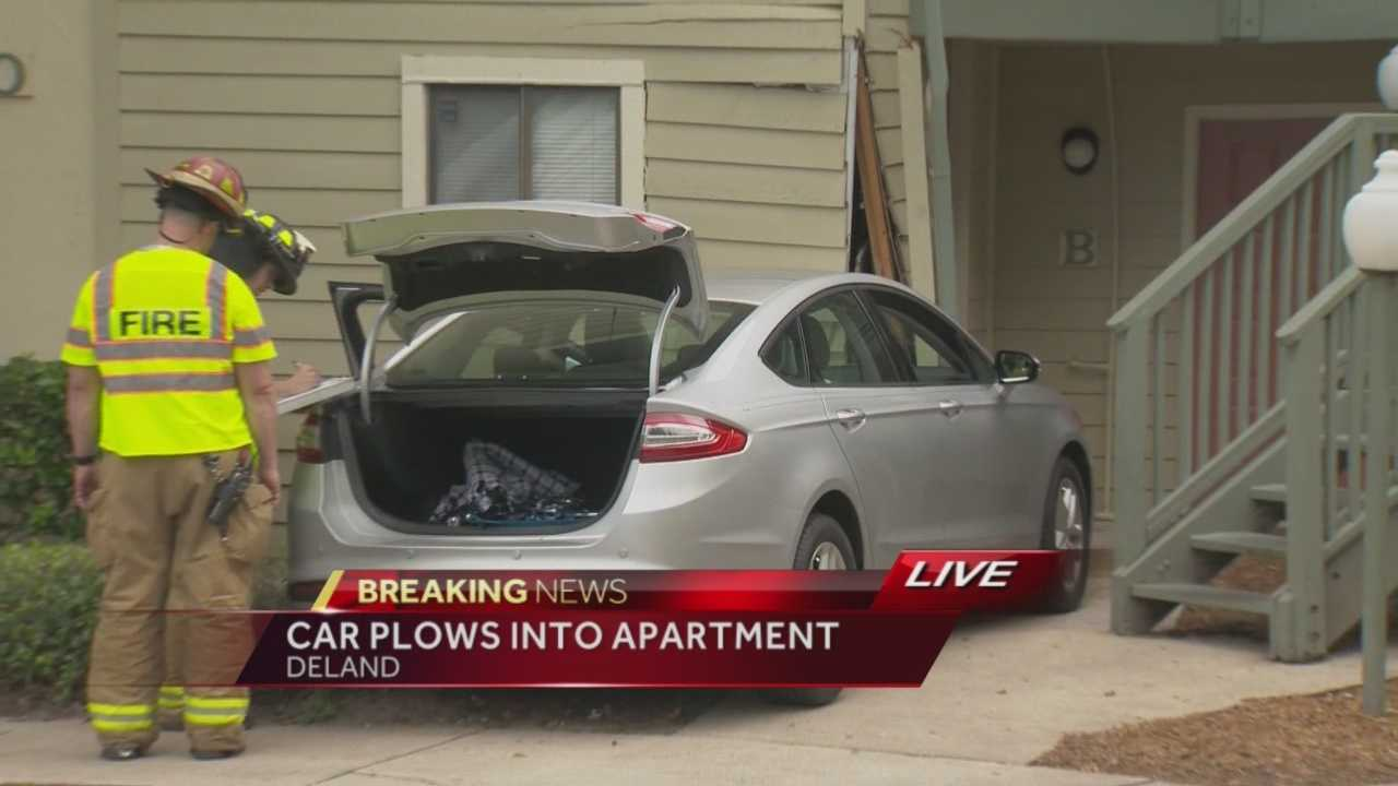 Woman drives car into DeLand apartment building