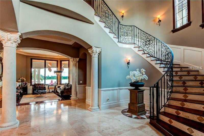 A semi-winding stair case leads to the second floor, and polished marble tile floors lead you the family room.