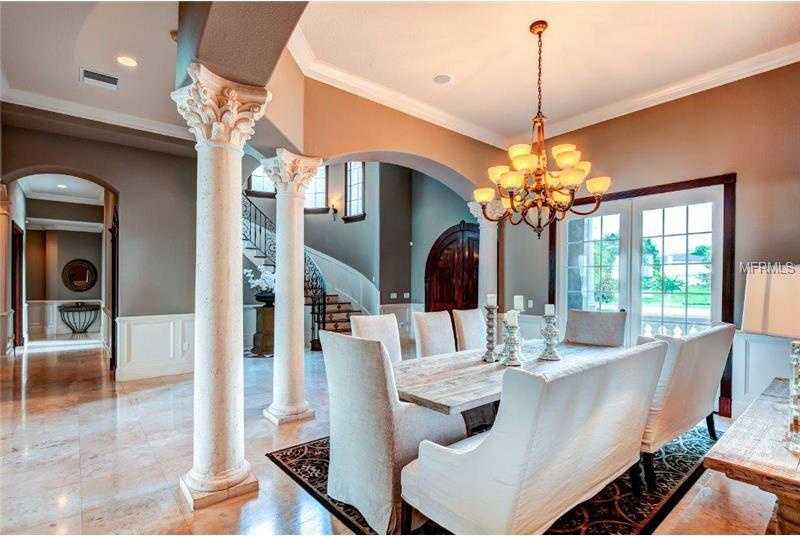 To the left of the foyer, you'll find exquisite pillars encircling the formal dining room.