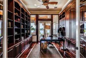 For the busy professional, a bold home office with private access to the pool.