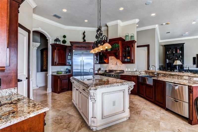 The kitchen boasts top-of-the line appliances, Viking granite counter tops,and beautiful cooking island with Vessel sinks.