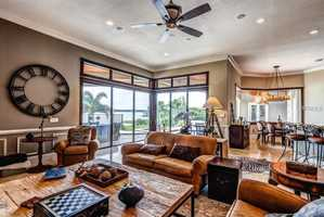 Sunlight flows into the family room and kitchen's open layout.