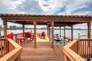 Fully powered boat house, dock and boat lift.