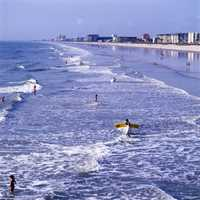1981: View showing surfers at Cocoa Beach