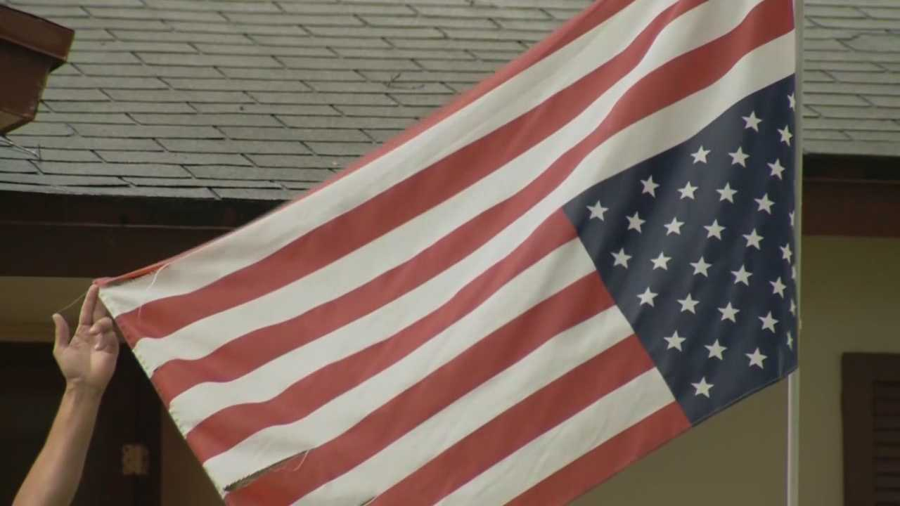 A Central Florida man turned his American flag upside down in protest of political decisions, but his neighbors say there are better ways for the man to share his opinions.