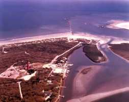 1975: An aerial view overlooking east over the Ponce de Leon Inlet near New Smyrna Beach