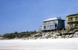 1986: A view of the beach houses with boulders placed to fight erosion in New Smyrna Beach