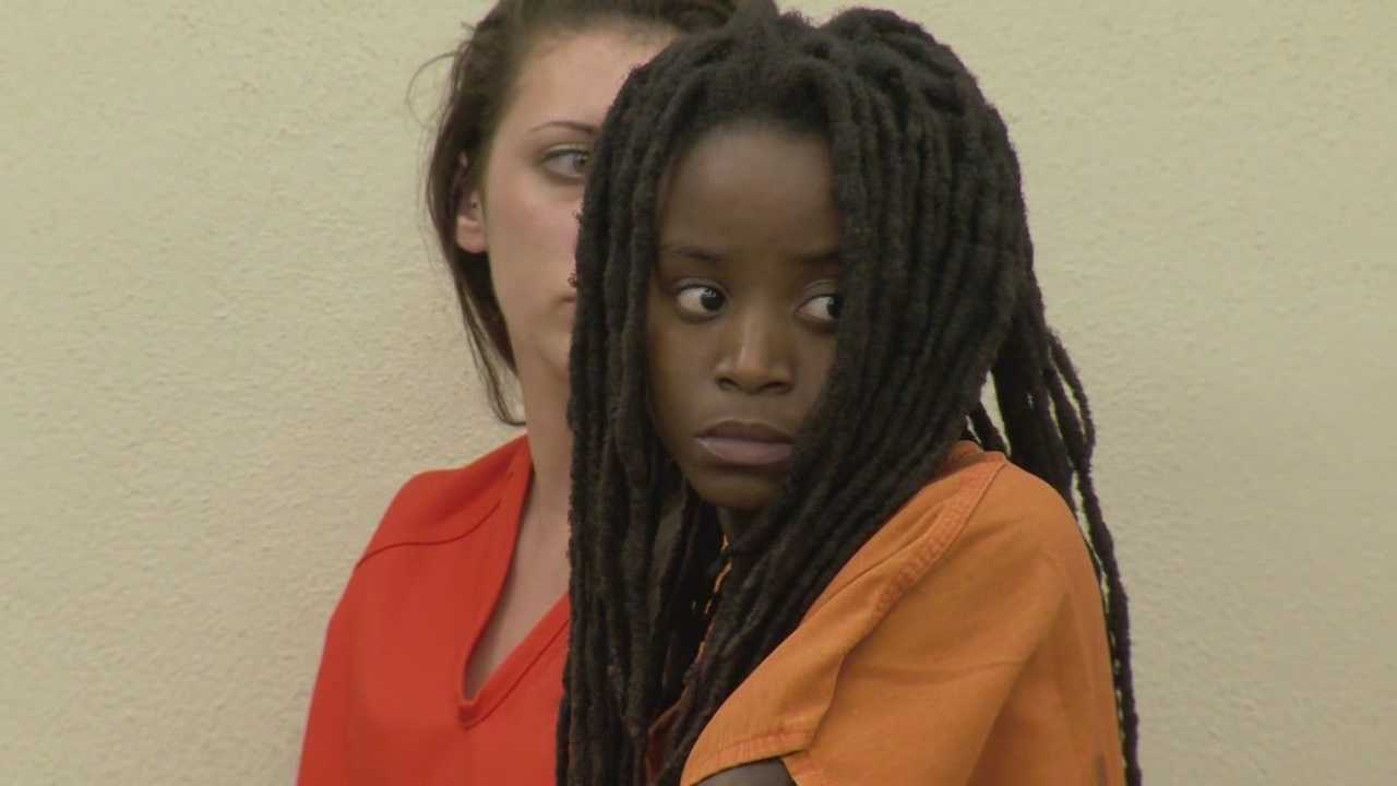 A judge has set a reduced the bond of $7,500 for Aisha Gillis, who is accused of attacking two family members with a machete at a family gathering near Daytona Beach.