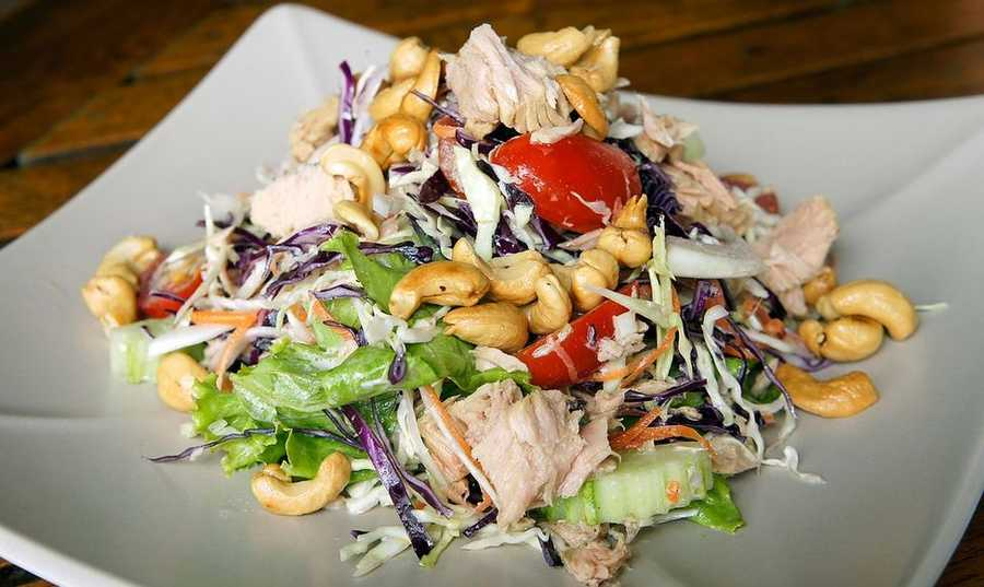 Tuna Salad with Cherries and WalnutsIn a small bowl, combine tuna and oil, cherries, walnuts, mayonnaise, and black pepper.Toast bread&#x3B; divide tuna evenly between two sandwiches.Layer each tuna sandwich with spinach and serve.