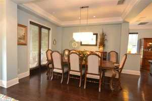 The dining room flows into the family room area.