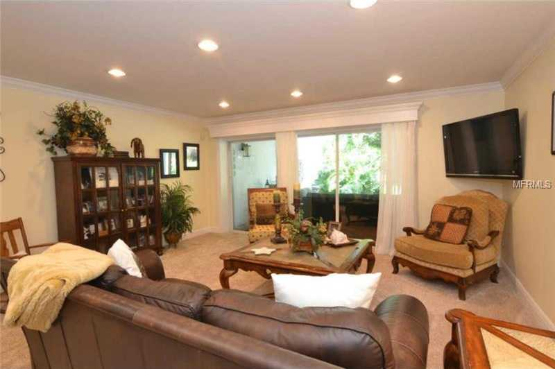 Downstairs, on the ground level, you will find an additional family room complete with three glass pocket doors that open up to your gorgeous salt water pool/entertainment area.