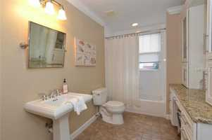 Spacious full bathroom shared by both bedrooms.