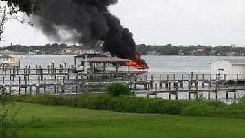Two men were delivering the boat to new owners when the fire started.