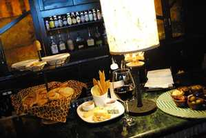 """Disney officials describe this new option as """"a sumptuous plate of artisanal cheeses featuring Valdeon blue cheese, Petit Agour sheep's milk cheese and Cabot Clothbound Cheddar with Marcona almonds, honeycomb, Egyptian flowers and wild strawberry gastrique."""""""