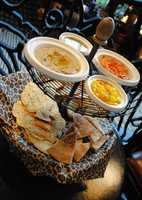 """Disney officials describe this new option as """"breads and spreads, which features oak-grilled pappadam, South African sea salt crisps, wheat pita and house-made lavosh served with hummus, mango chutney, lentil spinach and citrus spread."""""""