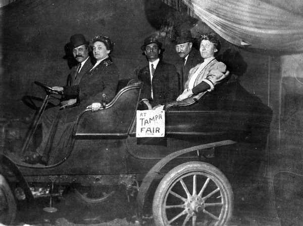 1909: Checking out an automobile at the Tampa Fair.
