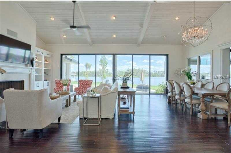 With 200 feet of walled lake frontage, incredible lake views can be taken in from the ground to ceiling doors and windows.