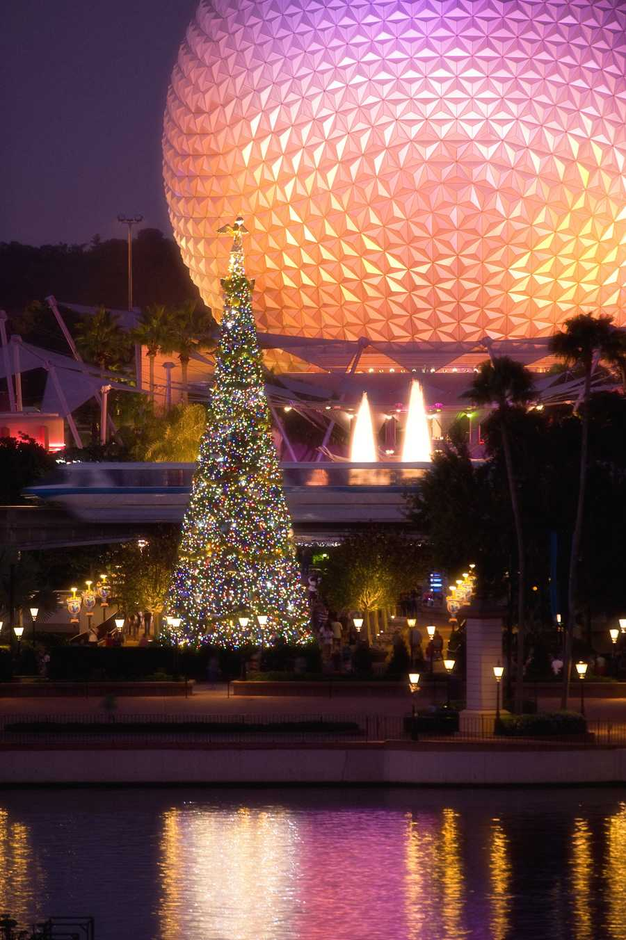 "The giant Christmas tree at Epcot, seen glistening in front of the iconic Spaceship Earth attraction, is the centerpiece of the holiday celebration. It's all part of the park's annual ""Holidays Around the World"" celebration, in which international traditions of the season unfold all throughout World Showcase."