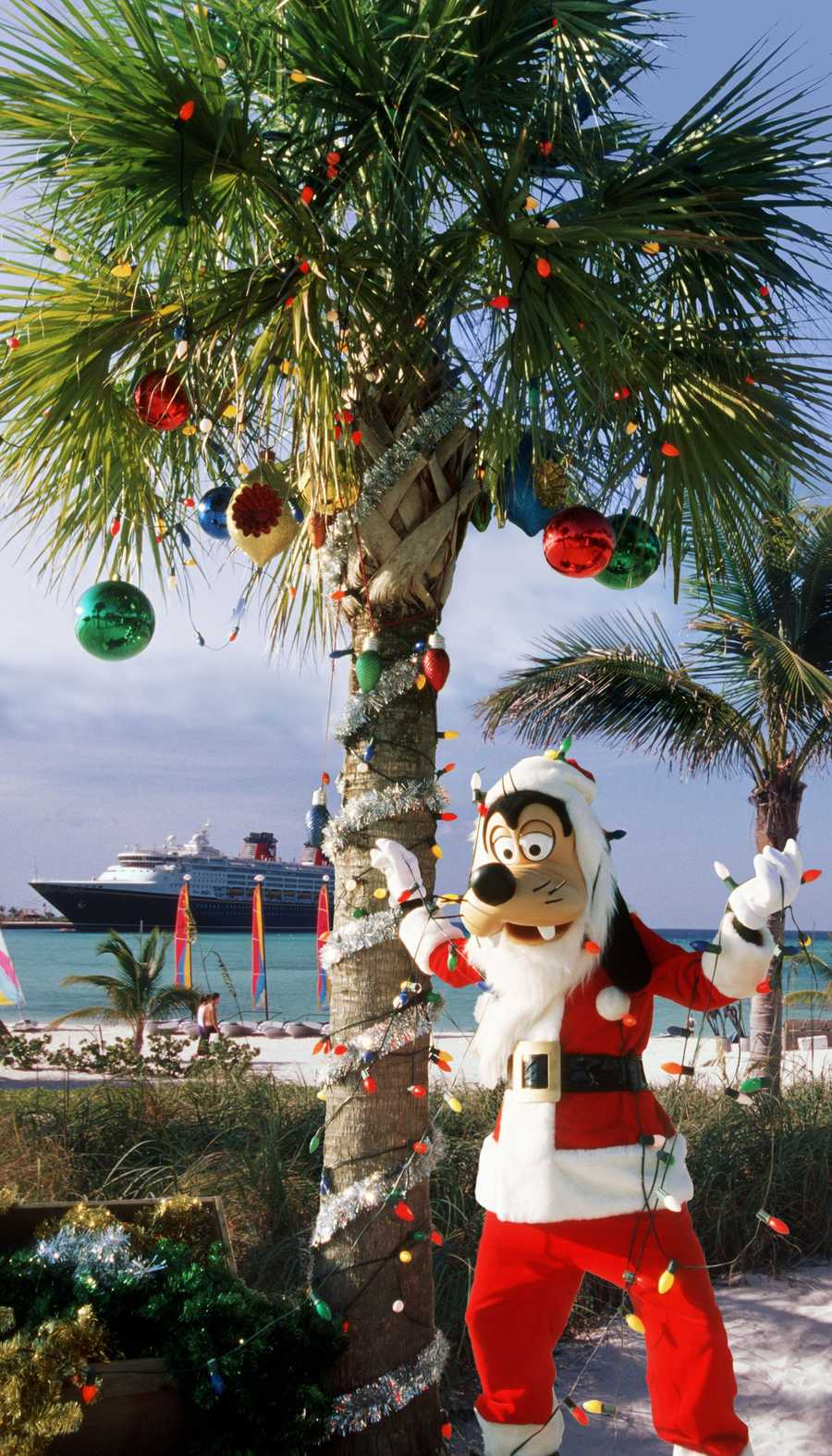 "The holidays take on the tropics at Disney's private island in the Bahamas, Castaway Cay, with ""snow flurries,"" a decked-out Christmas tree, Disney character meet-and-greets and holiday island music."