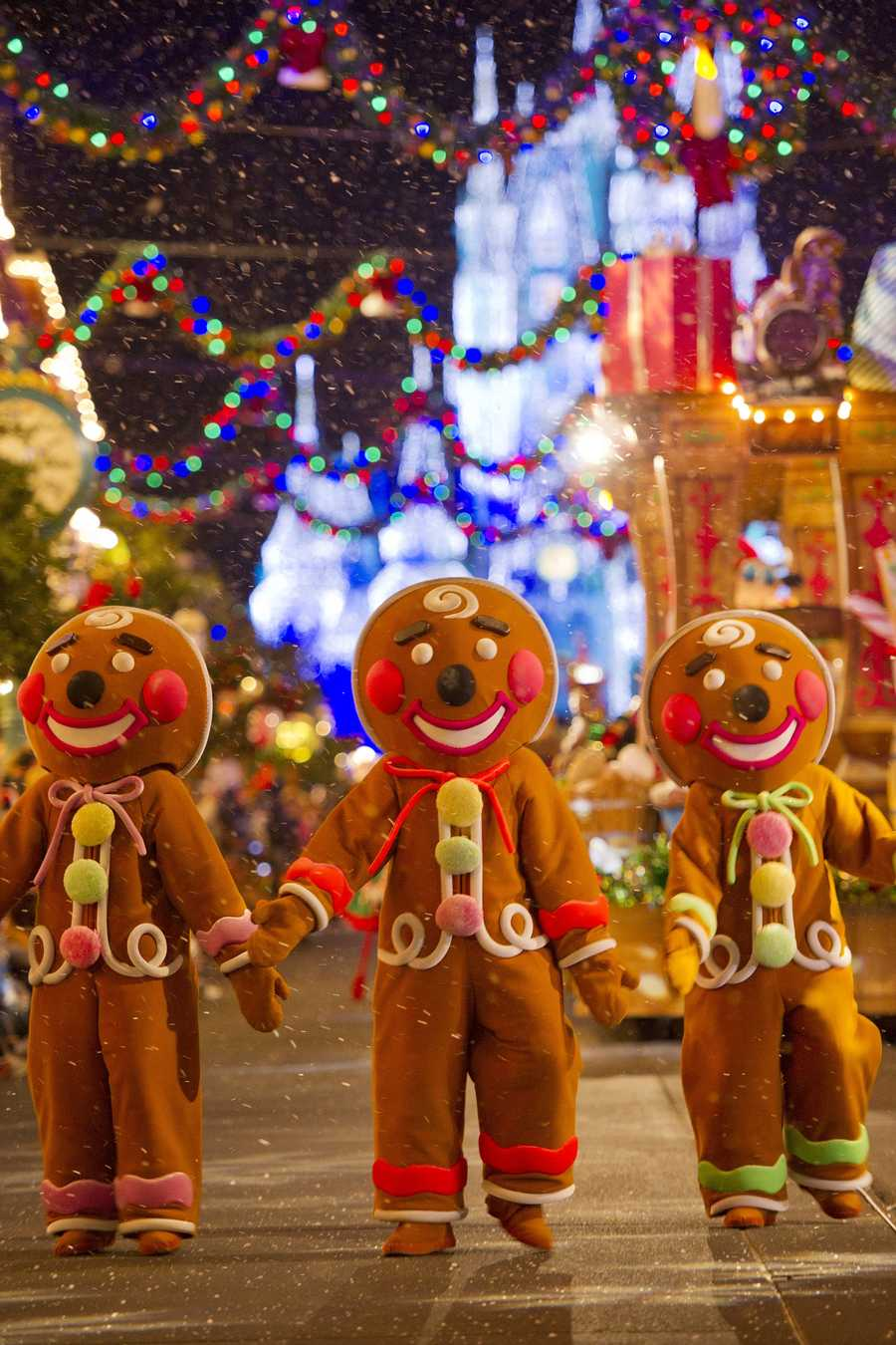 "Christmas Cookie Cavalcade: Life-size gingerbread men spread holiday cheer during ""Mickey's Once Upon a Christmastime Parade,"" a festive offering during Mickey's Very Merry Christmas Party."