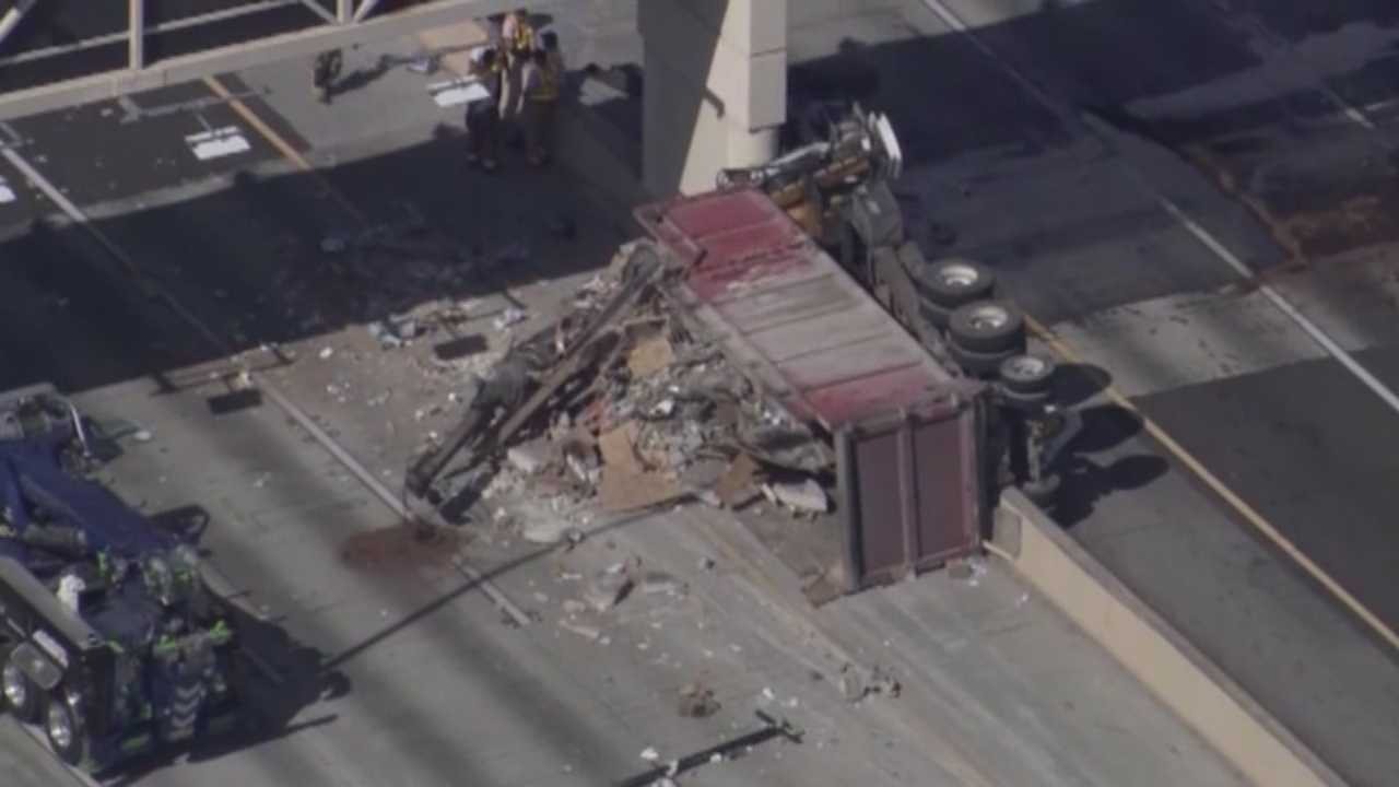 Crews are still working to reopen all lanes of SR 408 after a fatal crash involving a dump truck Wednesday morning.