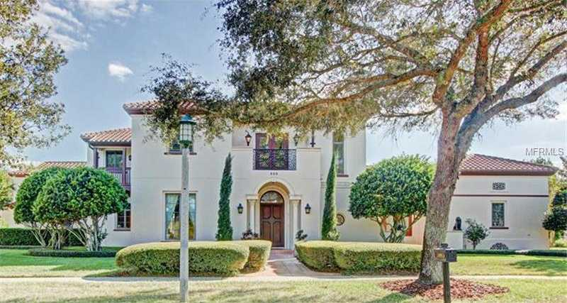 Peak inside the 6 bedroom, 5.5 bathroom property with sparkling water views, golf course views, and nightly fireworks courtesy of Disney.