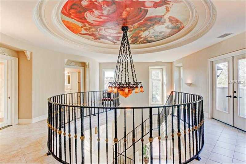 Grand foyer has tray ceiling accented with a rendition of the famous Michelangelo Sistine Chapel Paintings.