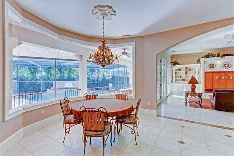 Kitchen is open to informal dining area & large family room.