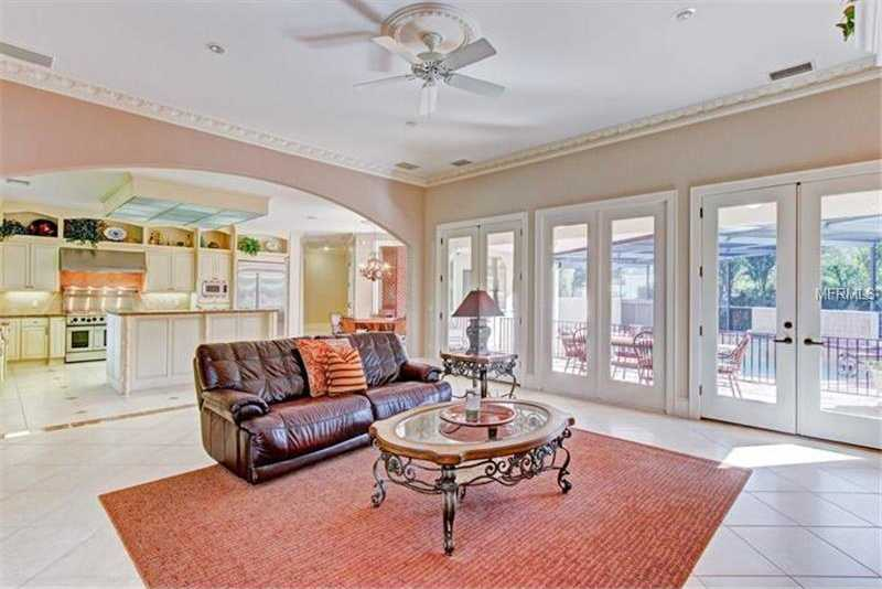 Large family room with access to the pool area.