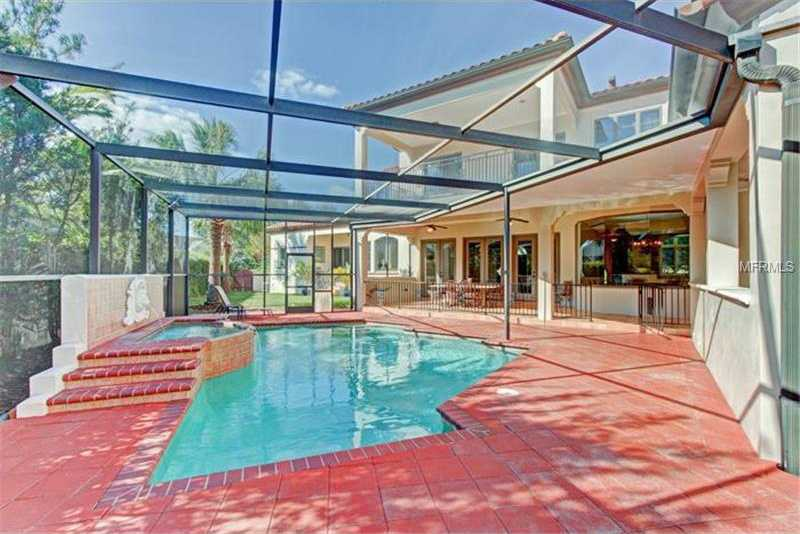 Heated pool&spa completes the screened enclosure.For more information, on this home visit Realtor.com .
