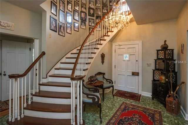 Grand foyer is both charming and elegant-- look closely to see the beautiful Cuban tile.