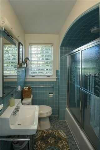 This en suite bathroom has a tub and shower.