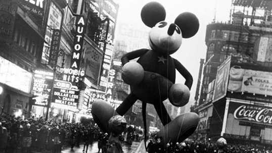 """7. Mickey Mouse made his first appearance in the """"Macy's Santa Claus Parade"""" in 1934, now the Thanksgiving Day Parade. He was 40-feet-tall! The balloon was hand-painted and guided by men and women dressed in Mickey and Minnie Mouse costumes."""