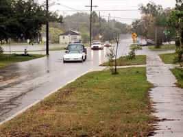 A white Corvette is helped out of the flood waters in Orange County.