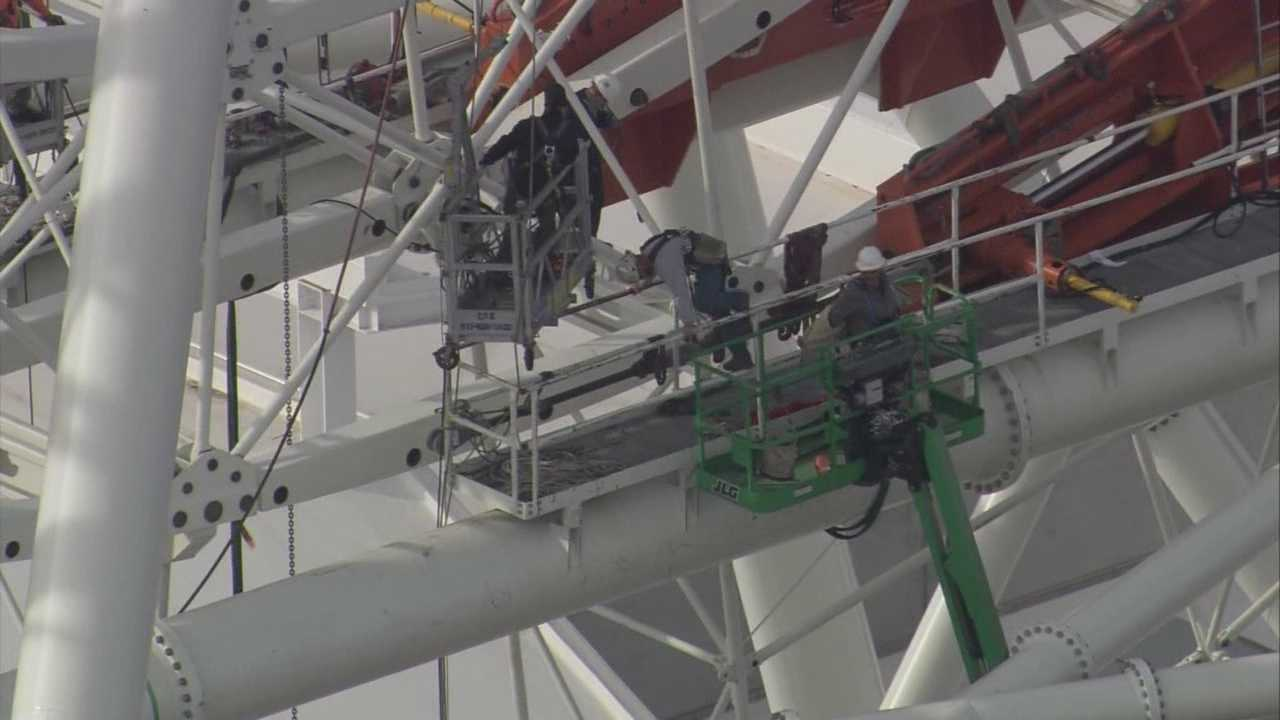 A Construction worker briefly became stuck on a platform while working on the soon-to-come Orlando Eye attraction on International Drive.