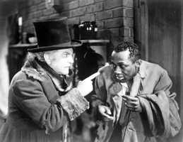 """Florida native, Lincoln Perry, playing servant Cicero, is on the right with Frank Morgan as Professor Eustace Appleby. The film """"Dimples"""" starred Shirley Temple in the title role and was directed by William A. Seiter."""