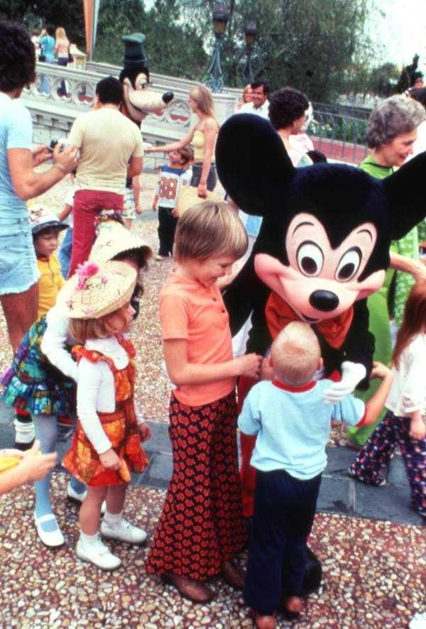 Mickey greeting children