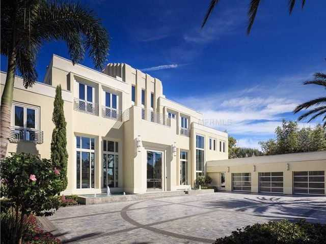 """Dubbed """"Overjoy"""" for the way you'll feel after touring this mansion. From the ginormous open floor plan, to the resort-like pool area, to the sparkling lake views this Windermere mansion is a perfect 10!"""