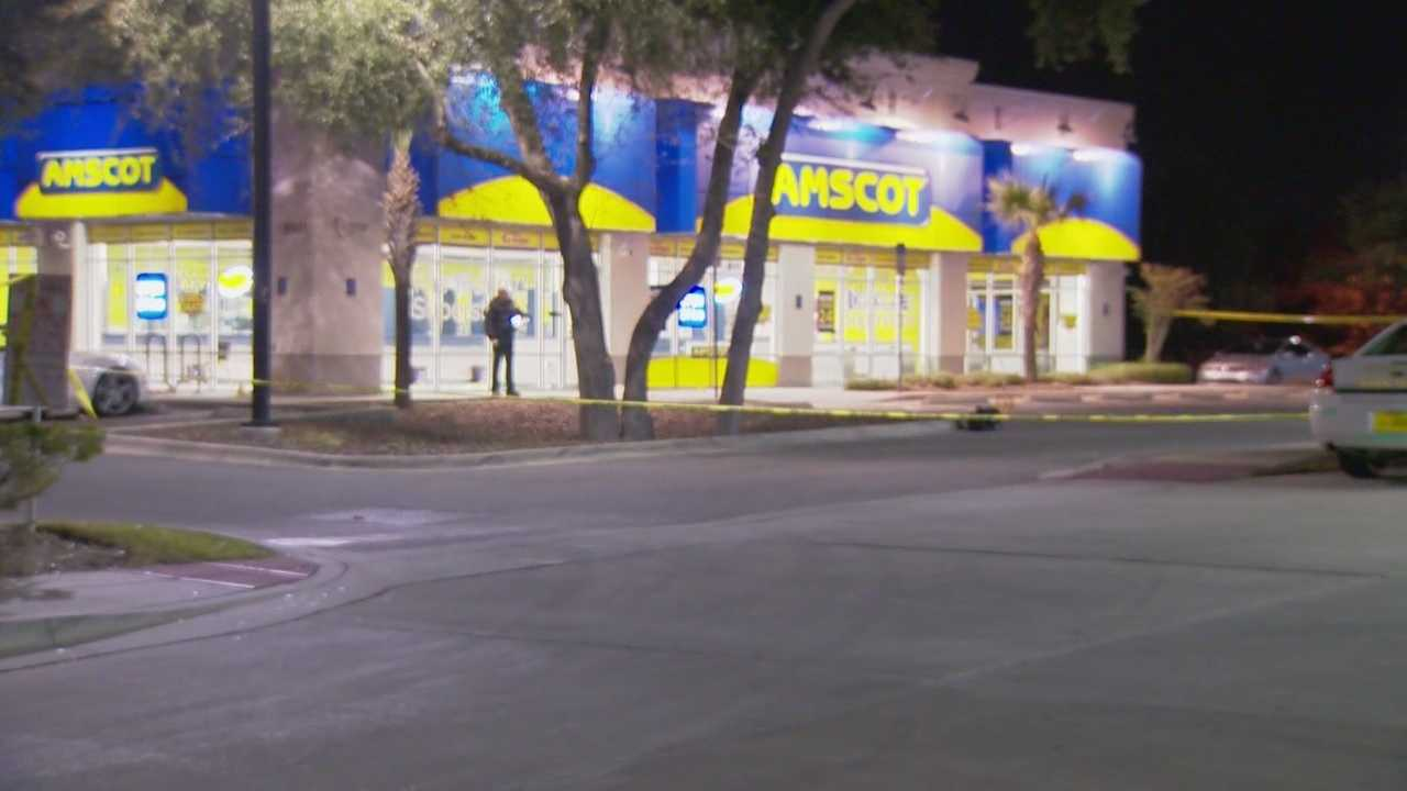 A man is dead after a shooting outside a business and the search is on for the man who killed him. It happened early this evening at the Amscot store on South John Young Parkway near Oakridge road.