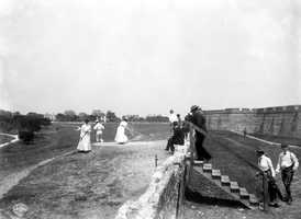 1902 - People playing golf by Fort Marion in Saint Augustine