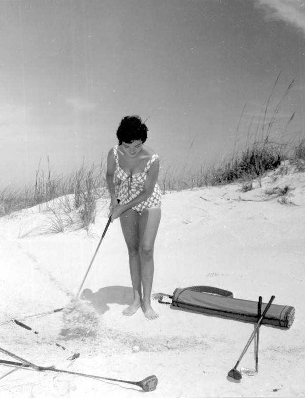 1960 - Marie Fajardo playing golf on the Daytona Beach sand