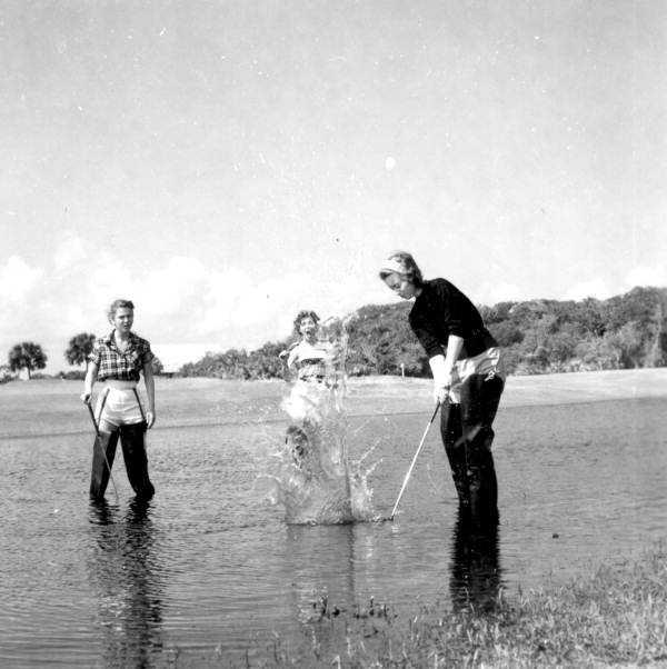 1971 - Golfers play in a water hazard in Daytona Beach