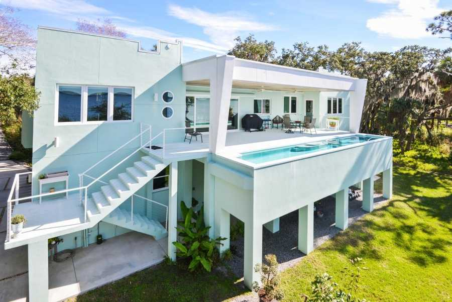 This $1.25M masterpiece looks out onto a sparkling Intracoastal Waterway with a 450 ft dock for boating, sits on 1.25 acres, and is close to the most possible tourist spots.