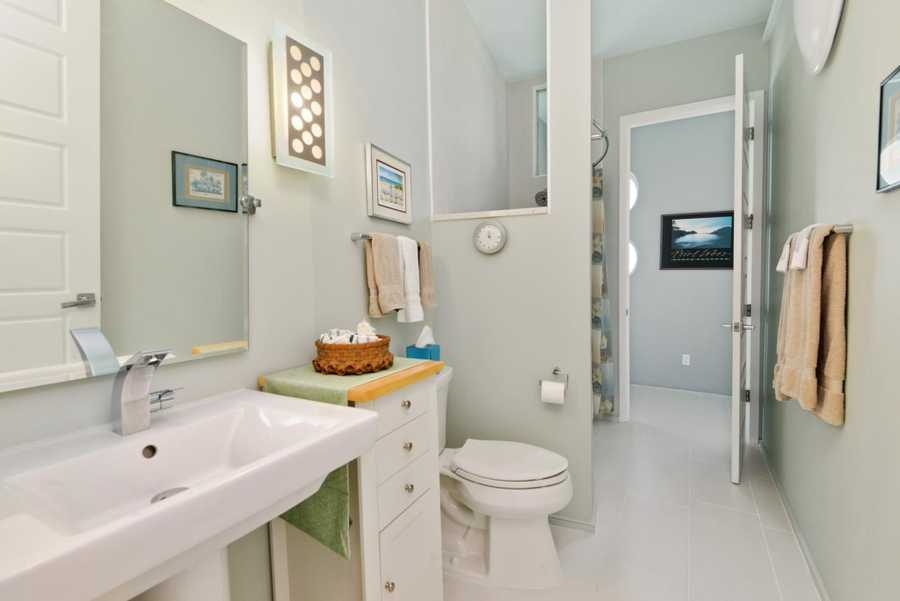 This bathroom is less extravagant but still boasts stylish, modern influences.